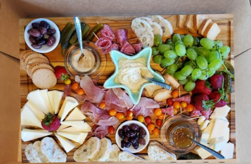 box with meats, cheese, crackers and fruit