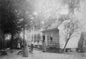 1889 House with family out front