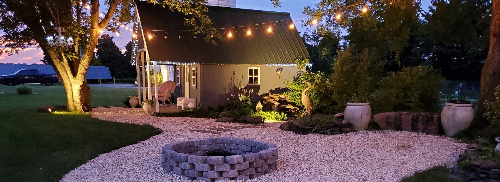 fire pit with stone all around and grey chairs
