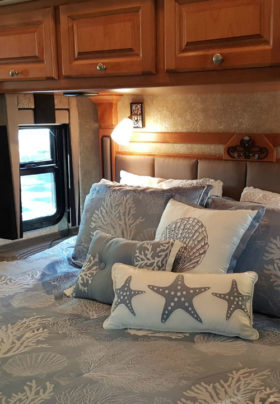 Seashell bedspread with starfish pillows