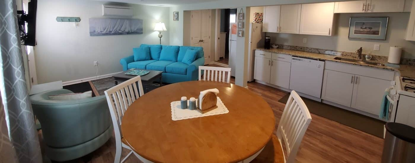 White cabinets with table and couch