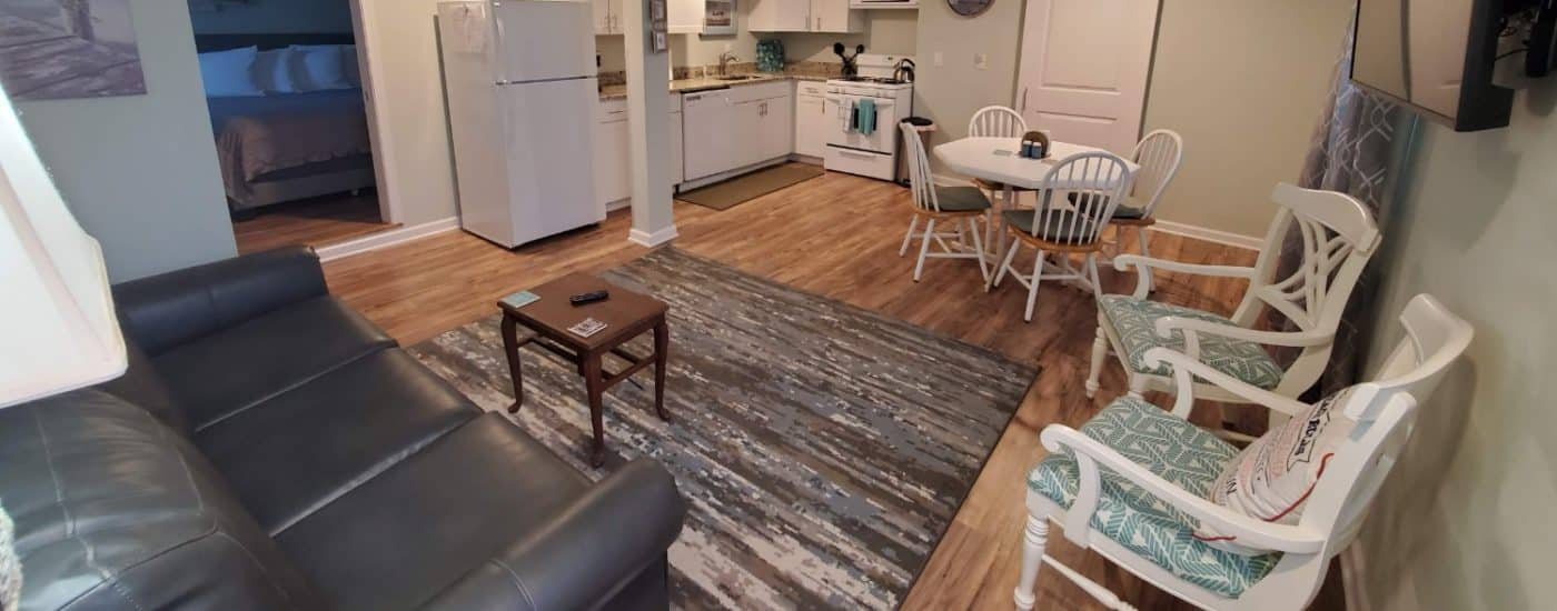 wide view of dining room, living room and kitchen