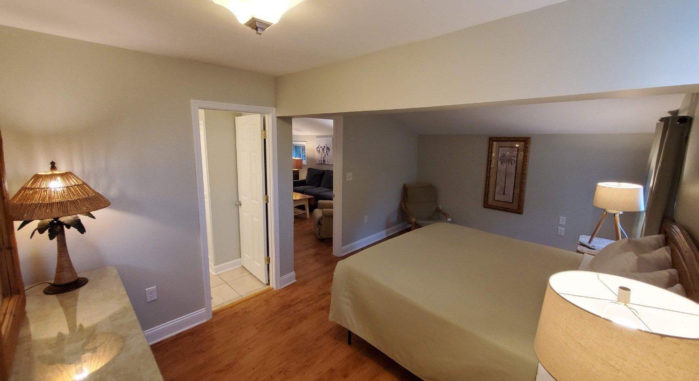Hardwood floors, green bedspread
