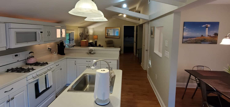 wood floors white kitchen cabinets