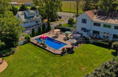drone view of back yard and pool
