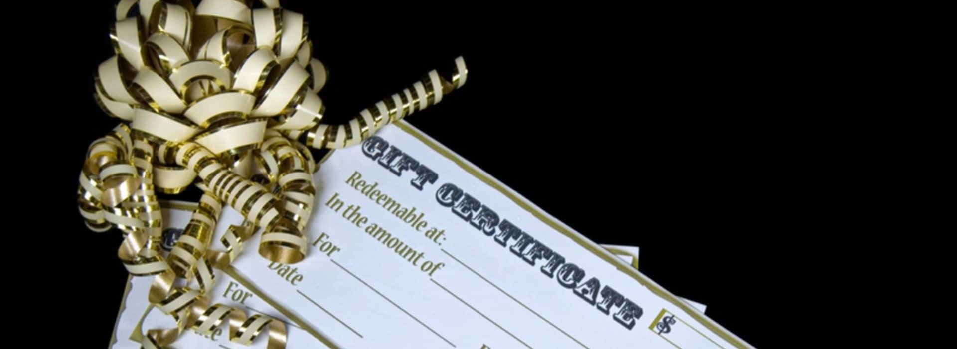 Gift Certificate, black background gold ribbon