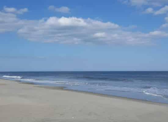 Sandy beach with ocean waves