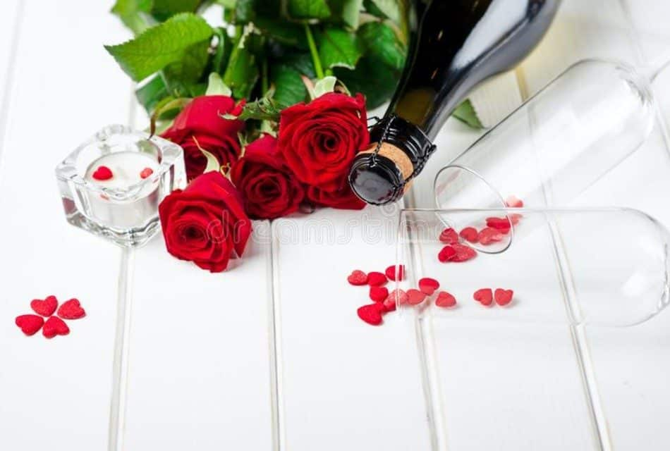 Red roses and bottle of wine
