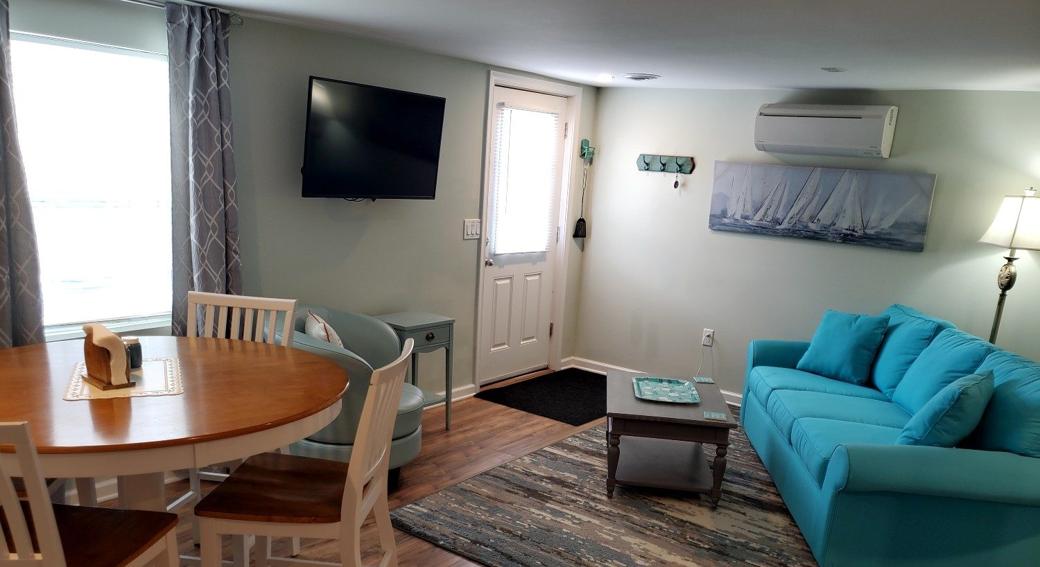 Blue couch with wood kitchen table