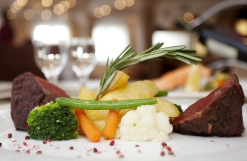 white plates with meat carrots