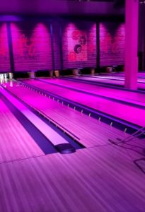 pic of Leftys bowling alley with purple tint from lights