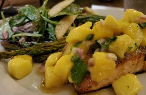 Plate of salmon with mango sauce